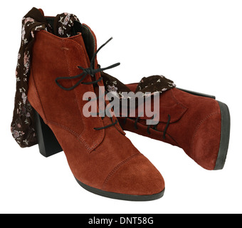 Female suede leather boots with tights isolated on white. - Stock Photo