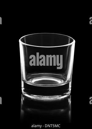 empty small shot glass isolated on black background - Stock Photo