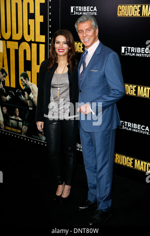 Announcer Michael Buffer and wife Christine Buffer attend the world premiere of 'Grudge Match' at the Ziegfeld Theatre. - Stock Photo