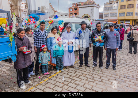 A large family grouping, at the blessing of the automobiles in front of the Basilica of Our Lady of Copacabana, - Stock Photo