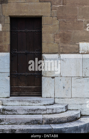 Ancient wooden door in the rear wall of Cathedral St. Pierre, Geneva, Switzerland, - Stock Photo