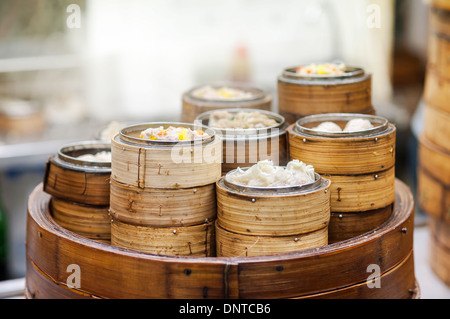 Dim sum steamers at a Chinese restaurant, Hong Kong - Stock Photo