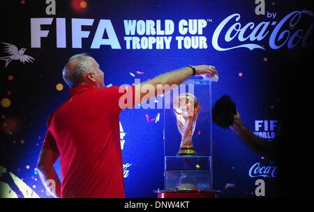 Jakarta, Indonesia. 6th Jan, 2014. Staff members clean the 2014 FIFA World Cup trophy during its presentation in - Stock Photo