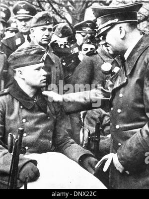Oct. 7, 1939 - Berlin, Germany - ADOLF HITLER talks to a wounded Nazi. Adolf Hitler (April 20, 1889-April 30, 1945) - Stock Photo