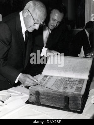 Oct 24, 1957 - Berlin, Germany - CECIL DEMILLE is presented with the Electoral Bible of 1798 by H. SCHAEFER during - Stock Photo