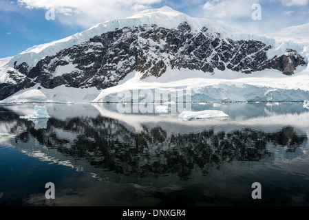 ANTARCTICA - The icy and rocky scenic landscape mountains covered in ice and snow at  Neko Harbour on the Antarctic - Stock Photo