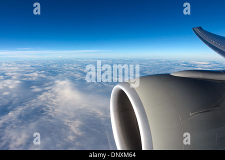 Clouds in the sky through aircraft window - Stock Photo