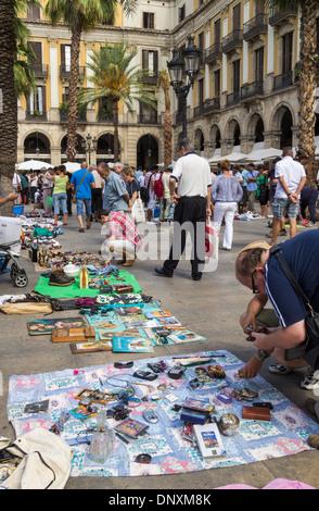 Sunday Flea market in Plaza Real in Barcelona, Spain - Stock Photo