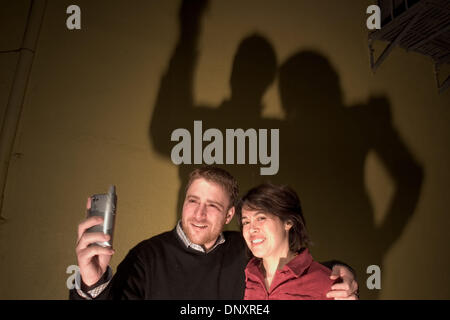 Dec 25, 2006 - San Francisco, CA, USA - Flickr co-founders STEWART BUTTERFIELD and CATERINA FAKE take a photo of - Stock Photo