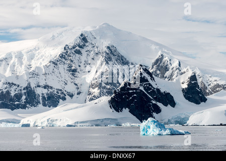ANTARCTICA - Large mountains rise up from the shore of the Gerlache Straigt on the western side of the Antarctic - Stock Photo