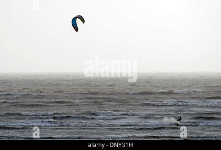Swansea, UK. 6th Jan, 2014. A kiteboarder makes the most of the windy conditions at Swansea Bay today. The West - Stock Photo