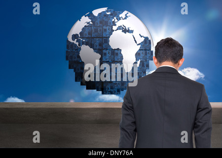 Composite image of futuristic earth floating in sky - Stock Photo