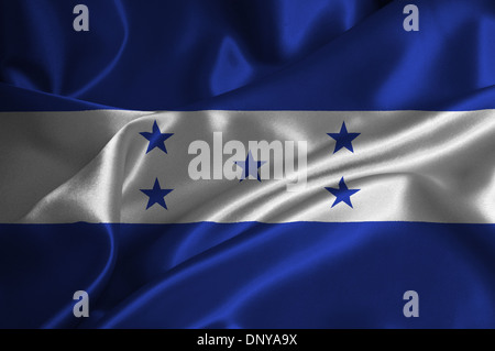 Honduras flag on satin texture. - Stock Photo