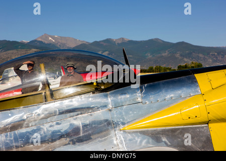 Visitors viewed through canopy of a Van's Aircraft RV4; Antique and modern airplanes at the annual Salida ArtWalk - Stock Photo