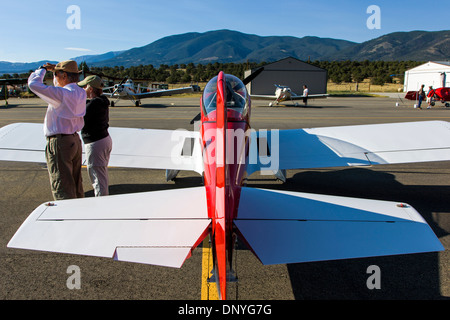 Couple enjoying antique and modern airplanes at the annual Salida ArtWalk Fly-In event; Van's Aircraft RV4. - Stock Photo