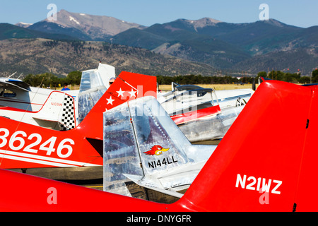 Abstract view of tail sections of antique and modern airplanes at the annual Salida ArtWalk Fly-In event - Stock Photo