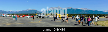 Panorama view of visitors inspecting antique and modern airplanes at the annual Salida, Colorado,  ArtWalk Fly-In - Stock Photo