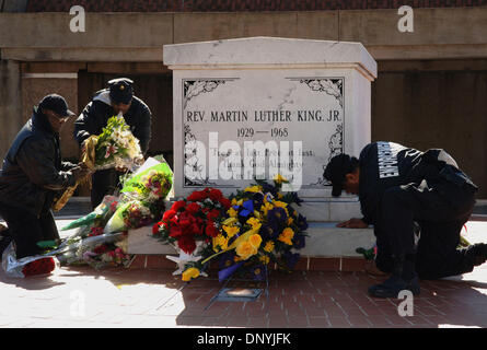 Jan 31, 2006; Atlanta, GA, USA; A security guard arranges flowers at MLK tomb that were left in tribute to Coretta Scott King on Jan. 31, 2006. Coretta Scott King died on Jan. 30 in her sleep at a Mexican rehabilitation center where she was undergoing holistic therapy for a stroke. Mandatory Credit: Photo by Robin Nelson/ZUMA Press. (©) Copyright 2006 by Robin Nelson