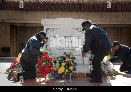 Jan 31, 2006; Atlanta, GA, USA; Security Guards arrange flowers at MLK tomb in Atlanta that were left in tribute to Coretta Scott King, who died yesterday.