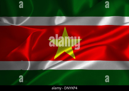 Suriname flag on satin texture. - Stock Photo