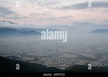 The city of Monterrey at daybreak from the Cerro de la Silla. - Stock Photo