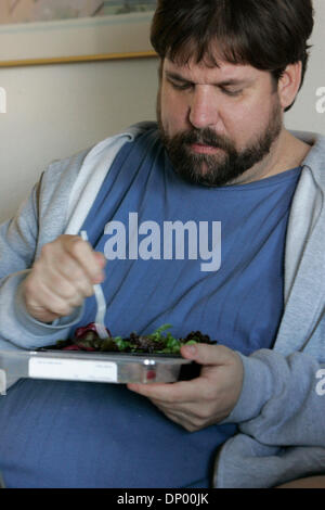 Feb 21, 2006; North Hollywood, CA, USA; STEVE VAUGHT eats (a salad) one of his new prepackaged meals at his hotel - Stock Photo