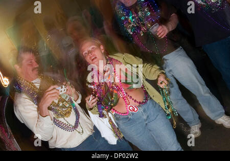 Feb 26, 2006; New Orleans, LA, USA; Party-goers on Bourbon Street in the French Quarter. Many locals in New Orleans - Stock Photo