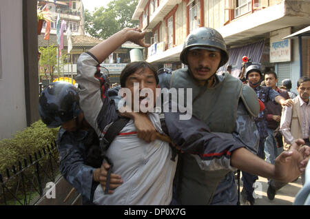 Apr 06, 2006; Kathmandu, NEPAL; Police arrest hundreds of protesters during a peaceful rally by professionals including - Stock Photo