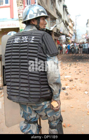 Apr 11, 2006; Kathmandu, NEPAL; Nepali People in Democracy movement: Armed police force carry bricks to throw at - Stock Photo
