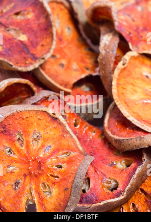 Slices of dried bael fruit - Stock Photo