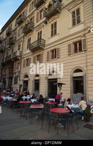 Cafe terraces in Via Cesare Battisti pedestrian street central Turin Piedmont region Italy Europe - Stock Photo