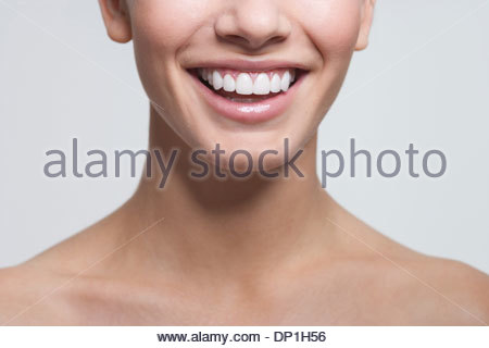 Close up of smiling womanÂ's mouth - Stock Photo