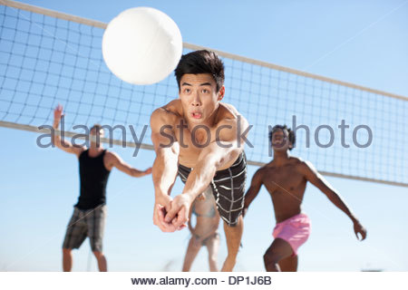 People playing beach volleyball - Stock Photo