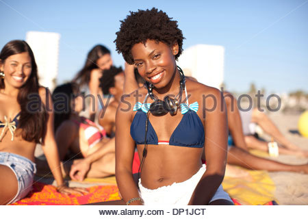 Woman wearing headphones on beach - Stock Photo