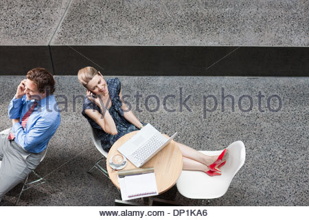 Business people talking on cell phone - Stock Photo