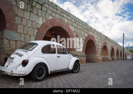 Old white bocho mexican and aqueduct. Oaxaca, Oaxaca. Mexico - Stock Photo