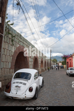 Old white bocho mexican and aqueduct. Oaxaca, Oaxaca. Mexico - Stock Photo
