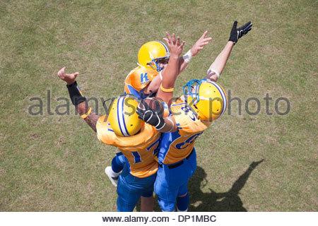Winning football player cheering - Stock Photo