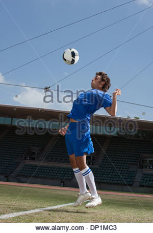 Soccer player playing soccer ball - Stock Photo