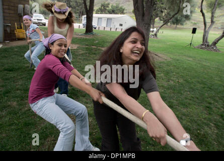 May 06, 2006; San Diego, CA, USA; Prospective adoptive parent BHAVNA MISTRY, right, plays tug-of-war with children - Stock Photo