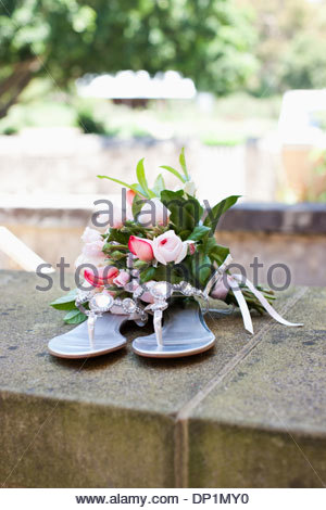 Bouquet and sandals - Stock Photo