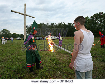 May 06, 2006; Red Bay, AL, USA; National Knights of the Ku Klux Klan member Phillip McCalpin, left, passes the flame - Stock Photo