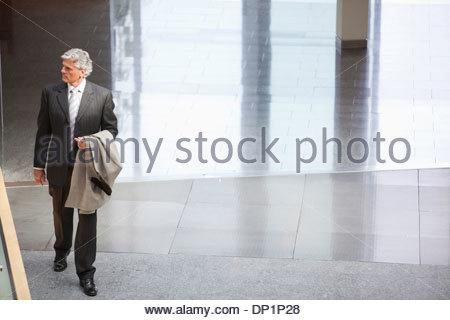 Businessman in lobby - Stock Photo