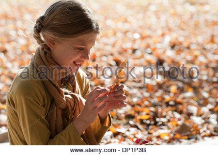 Girl outdoors in autumn - Stock Photo