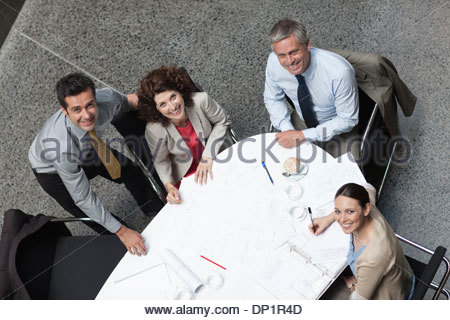 Directly above business people meeting at conference table - Stock Photo