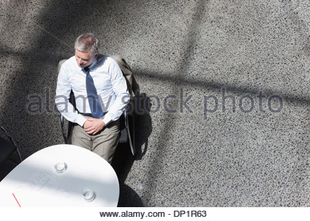 Businessman sitting at conference room - Stock Photo