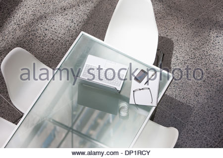 Laptop and water glass on conference table - Stock Photo