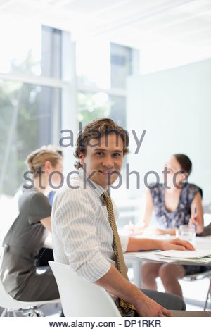 Businessman and co-workers meeting at conference table - Stock Photo