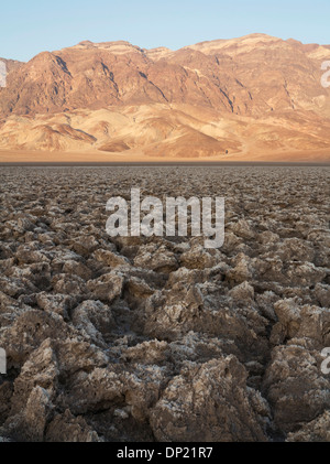Eroded rock salt pinnacles on the Devil's Golf Course, a salt pan in the Death Valley, Badwater Basin - Stock Photo