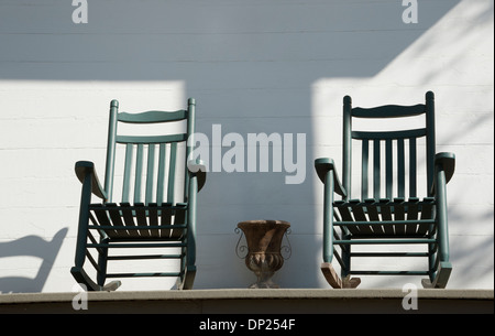 A pair of old wooden rocking chairs American USA - Stock Photo